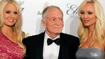 Playboy magazine founder Hugh Hefner and girlfriends Anna Sophia Berglund (L) and Shera Bechard arrive at the Society of Singers annual dinner in Beverly Hills, California September 19, 2011. REUTERS/Fred Prouser (UNITED STATES - Tags: ENTERTAINMENT MEDIA TPX IMAGES OF THE DAY)