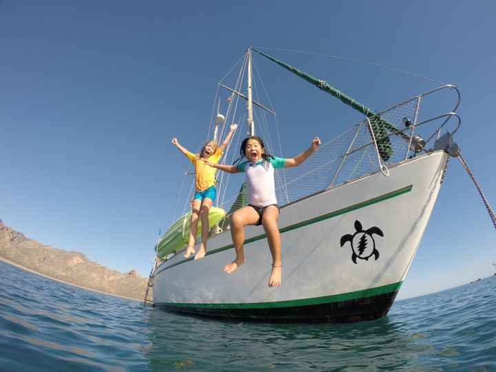Jessica (left) loves learning about the geography and cultures of the places to which she and her family sails. Emma (right) enjoys swimming, snorkeling and being in the water every day.