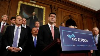 Surrounded by fellow Republicans, Speaker of the House Paul Ryan speaks about the Republican tax plan in the U.S. Capitol in Washington, U.S., September 27, 2017. REUTERS/Kevin Lamarque
