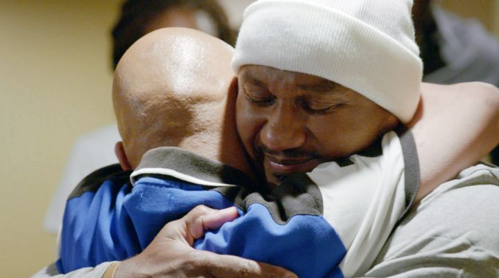 Kevin hugs and greets family members and friends after his release from prison.