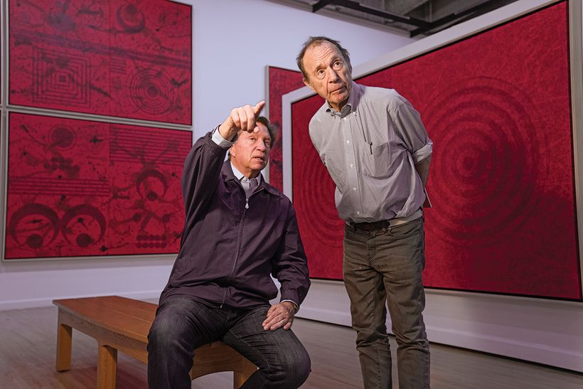 "J. Steven Manolis and art critic Anthony Haden-Guest reviewing elements of the ""Painting Vermillion Red"" exhibit at the John"