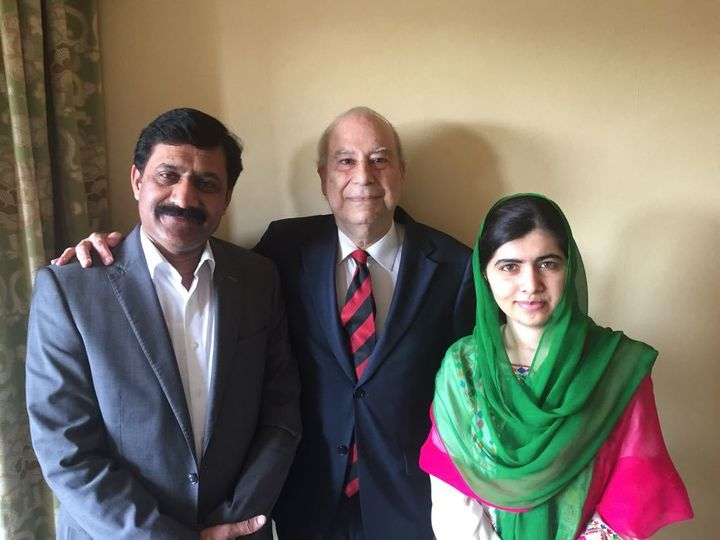 Ambassador Ahmed (center) meets with Malala Yousafzai and her father, Ziauddin Yousafzai, during their recent visit to Washin
