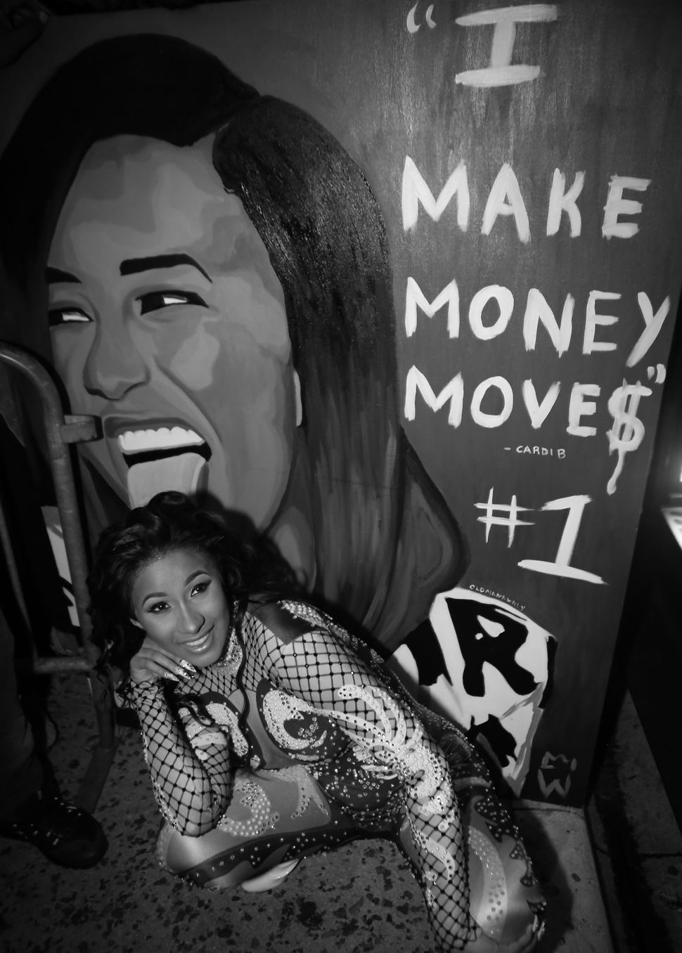 Cardi B poses with a fan made painting while leaving Revolution Live on Sept. 25, 2017 in Fort Lauderdale, Florida.&nbsp