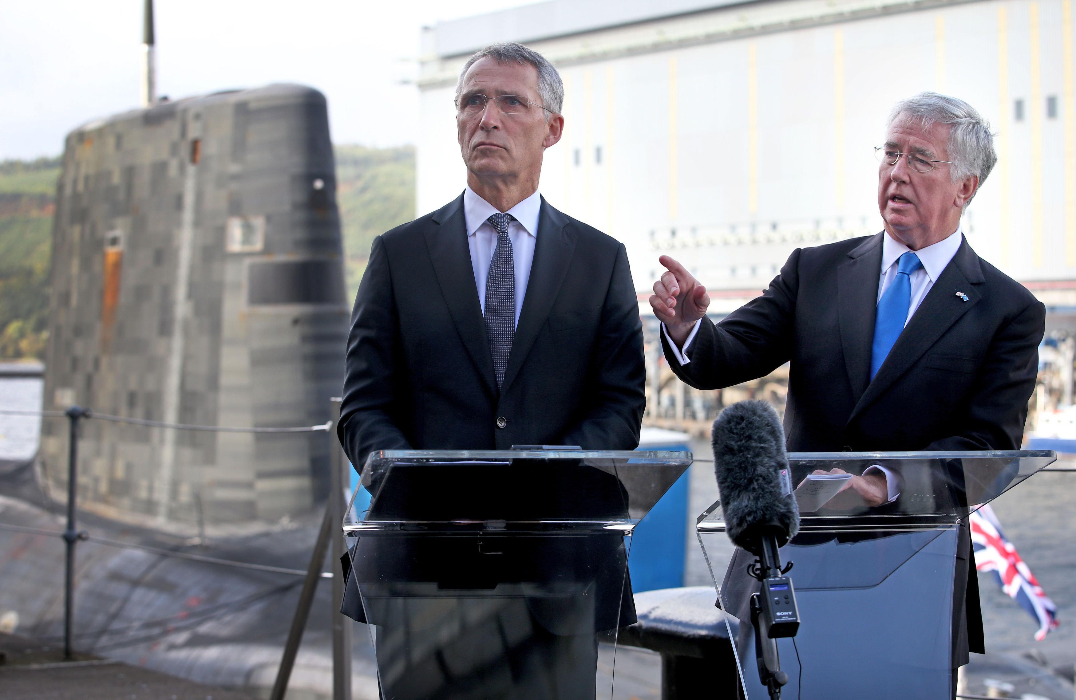 Defence Secretary Sir Michael Fallon and Nato Secretary General Jens Stollenberg speak to the media alongside...