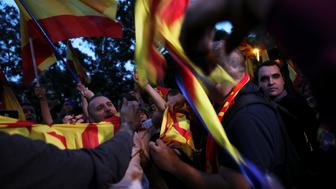 Protesters against a banned referendum on independence in Catalonia tear Esteladas (Catalan separatist flag) during a demonstration in Barcelona, Spain, September 22, 2017. REUTERS/Susana Vera