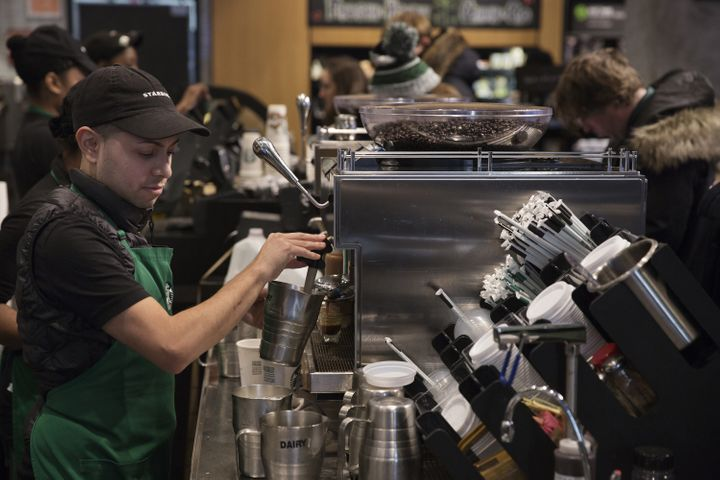 A barista froths milk for a drink inside a Starbucks shop in New York. Shareholders of the company are criticizing how i