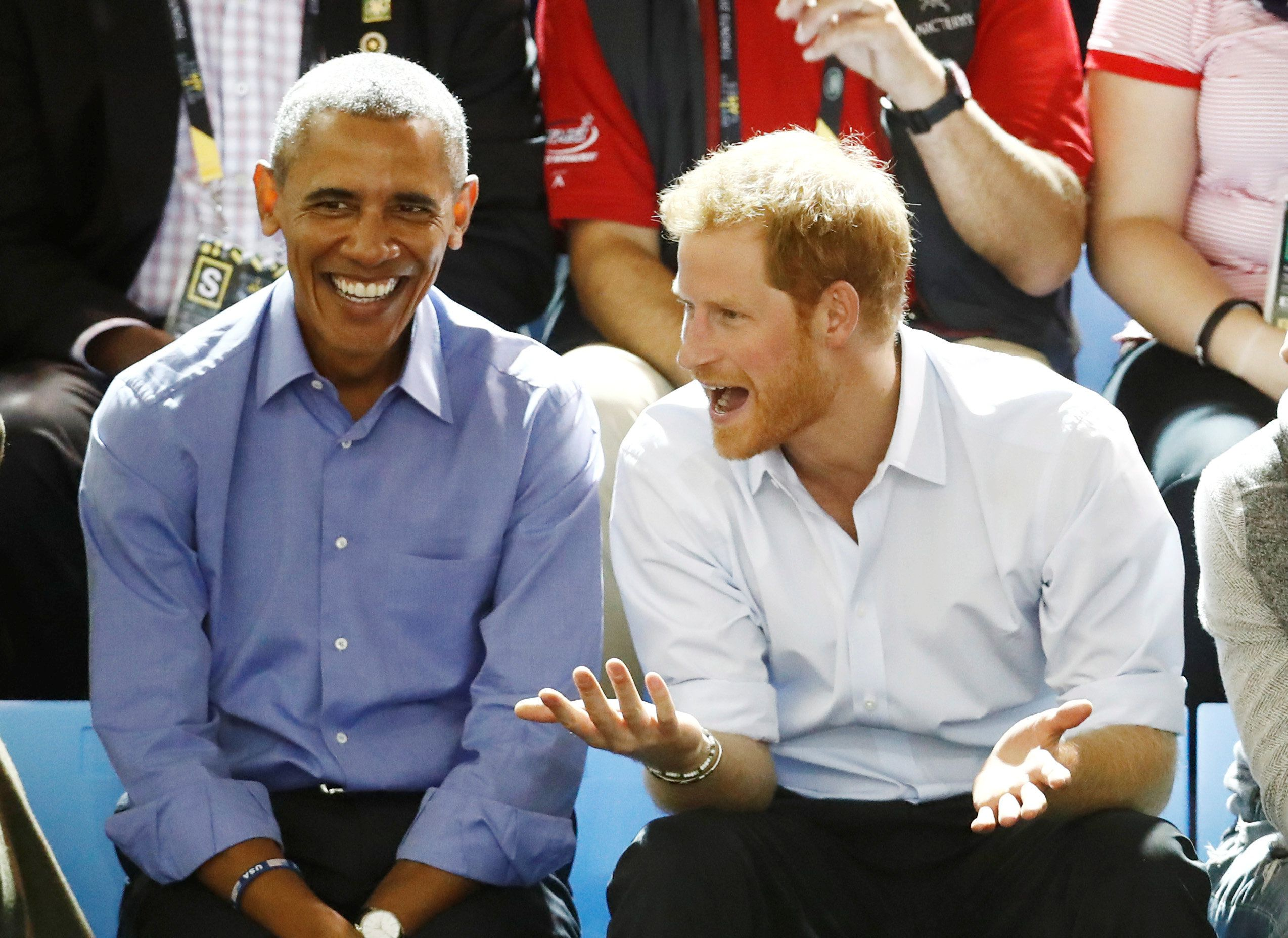 Britain's Prince Harry (R) and former U.S. President Barack Obama watch a wheelchair basketball event during the Invictus Games in Toronto, Ontario, Canada September 29, 2017.    . REUTERS/Mark Blinch
