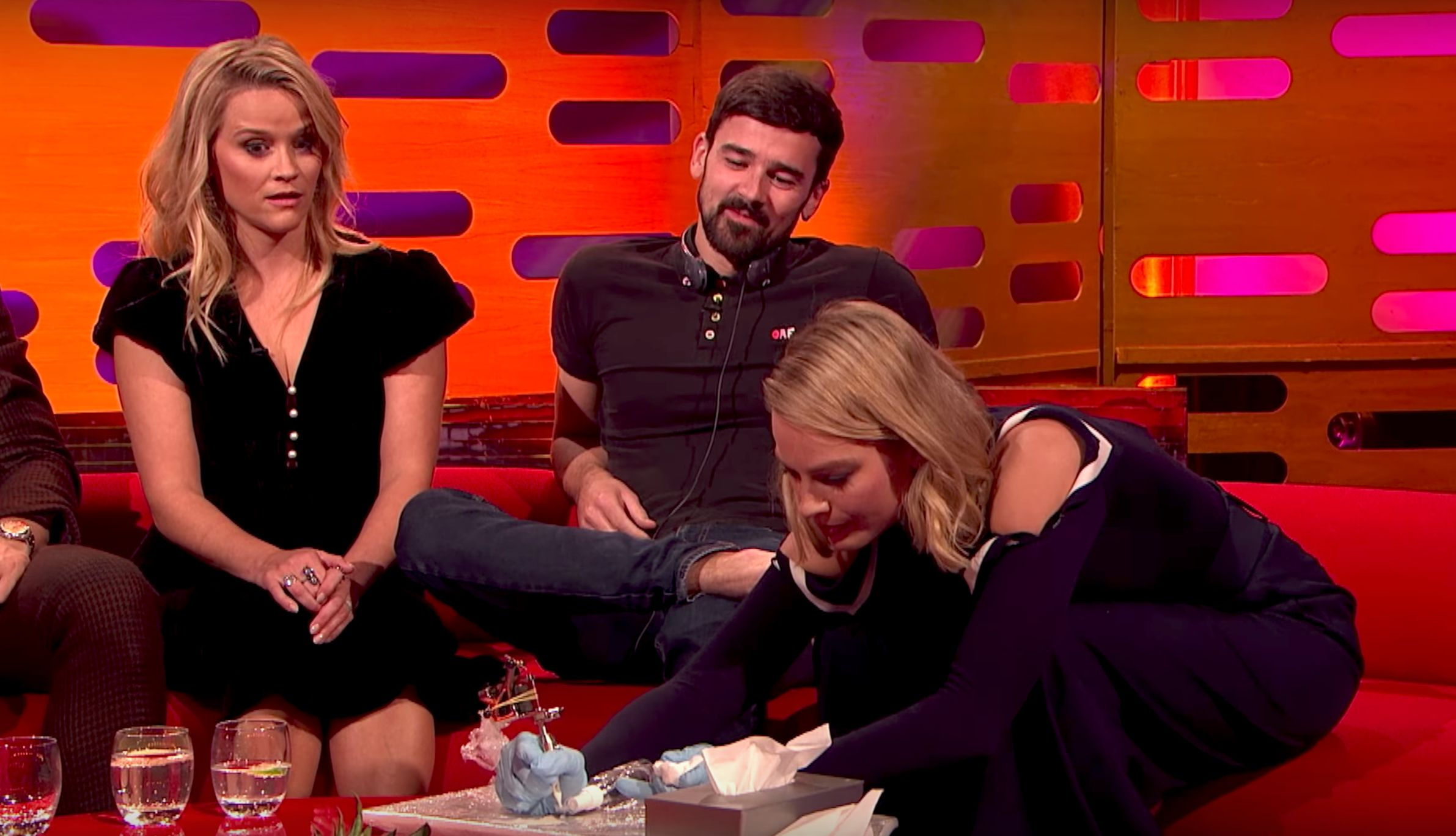 Margot Robbie Just Nervously Tattooed A Fan During A TV Interview""