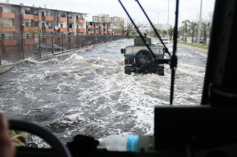 Citizen-Soldiers of the Puerto Rico National Guard patrol one of the main highway of the metropolitan area, affected by the f