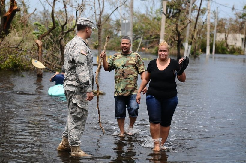 Citizen- Soldier help a couple getting away of the flooded areas in Condado, San Juan, Puerto Rico after the path of Hurrican