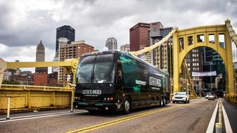"""PITTSBURGH, PA - SEPTEMBER 30: The HuffPost tour bus drives away from the Pittsburgh skyline via the Roberto Clemente Bridge on it's way to Akron, Ohio on Sept. 30, 2017, as part of """"Listen To America: A HuffPost Road Trip."""" The outlet will visit more than 20 cities on its tour across the country. (Photo by Damon Dahlen/HuffPost) *** Local Caption ***"""