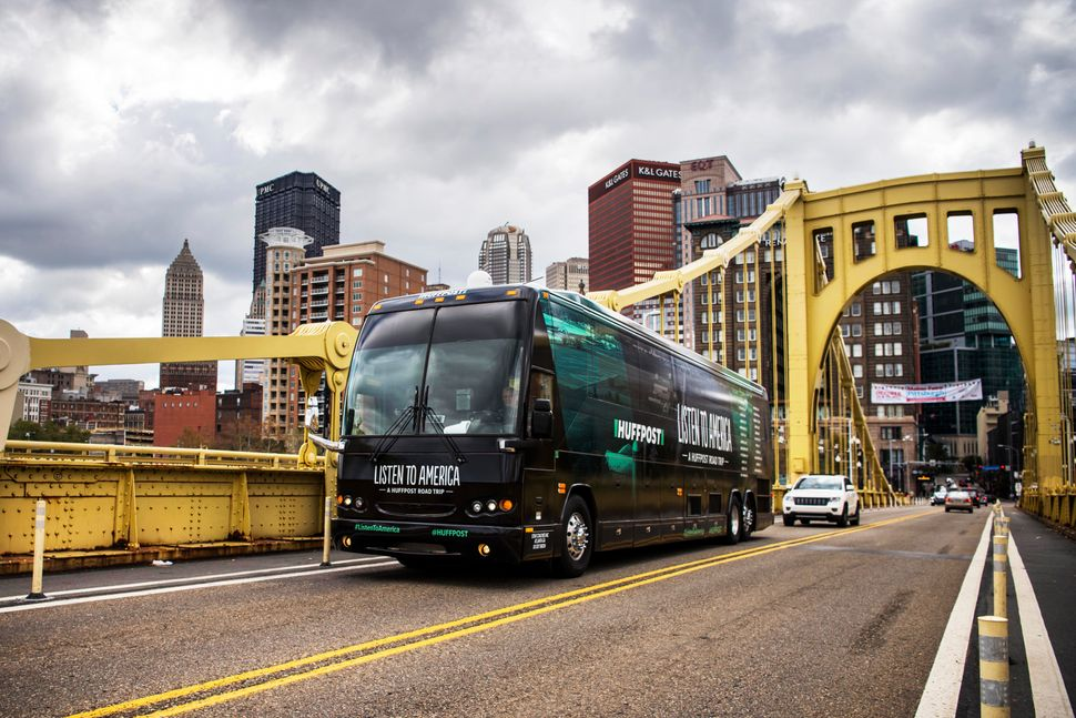The HuffPost tour bus drives away from Pittsburgh on Saturday via the Roberto Clemente Bridge.