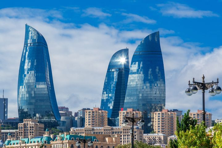 Baku, Azerbaijan - October 2, 2016: Flame Towers in the cityscape. Panoramic view of Baku - the capital of Azerbaijan located