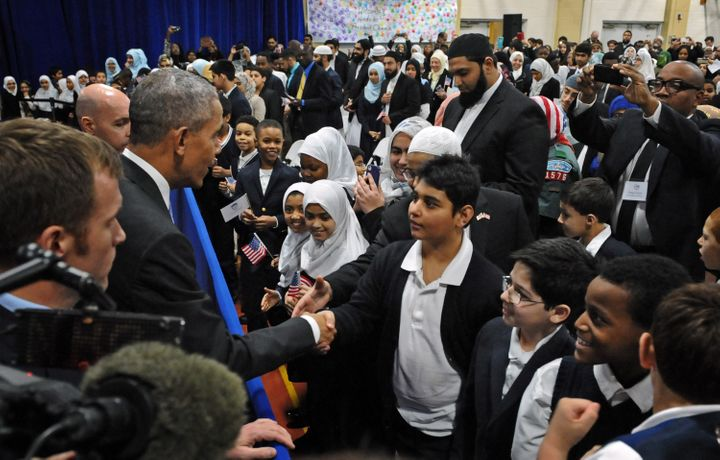 Obama greets students from Al-Rahmah school during his visit to the Islamic Society of Baltimore.