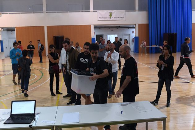 Ballot boxes arrive atthe polling station whereCarles Puigdemont was expected to vote. He...