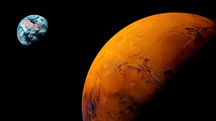 <p>The Red Planet, in a not-to-scale view with far away Terra.</p>