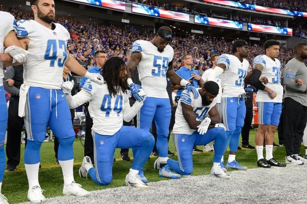 Jalen Reeves-Maybinof the Detroit Lions and teammate Steve Longa take a knee during the national anthem...