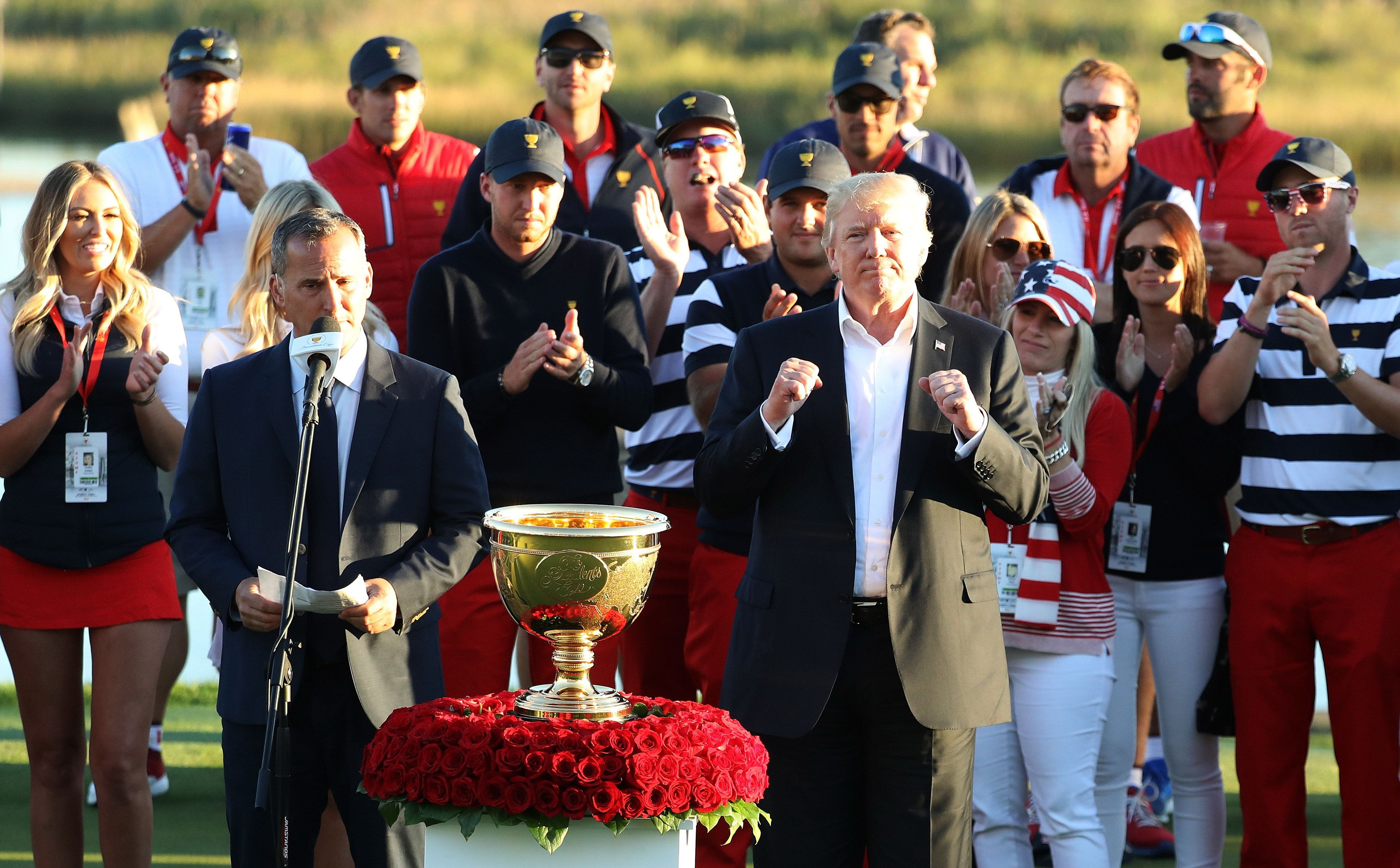 JERSEY CITY, NJ - OCTOBER 01:  U.S. President Donald Trump presents the U.S. Team with the trophy after they defeated the International Team 19 to 11 in the Presidents Cup at Liberty National Golf Club on October 1, 2017 in Jersey City, New Jersey.  (Photo by Rob Carr/Getty Images)