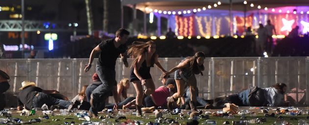People flee from theRoute 91 Harvest country music festival after gunfire was
