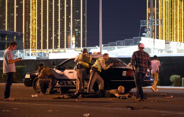 Policeguard along the streets outside the the Route 91 Harvest country music festival grounds after...