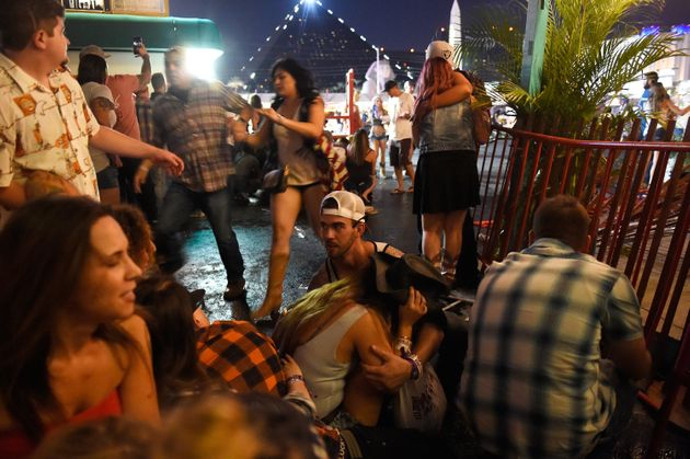 People run for cover at the Route 91 Harvest country music festival after gunfire