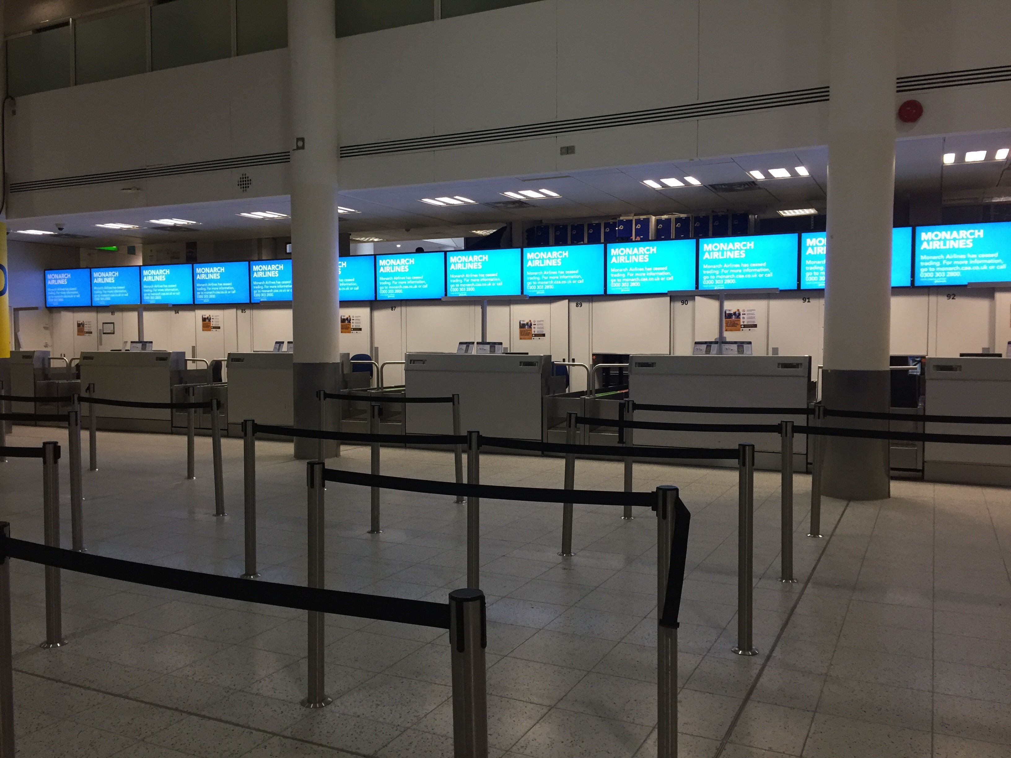 Empty Monarch desks at Gatwick Airport airport on Monday
