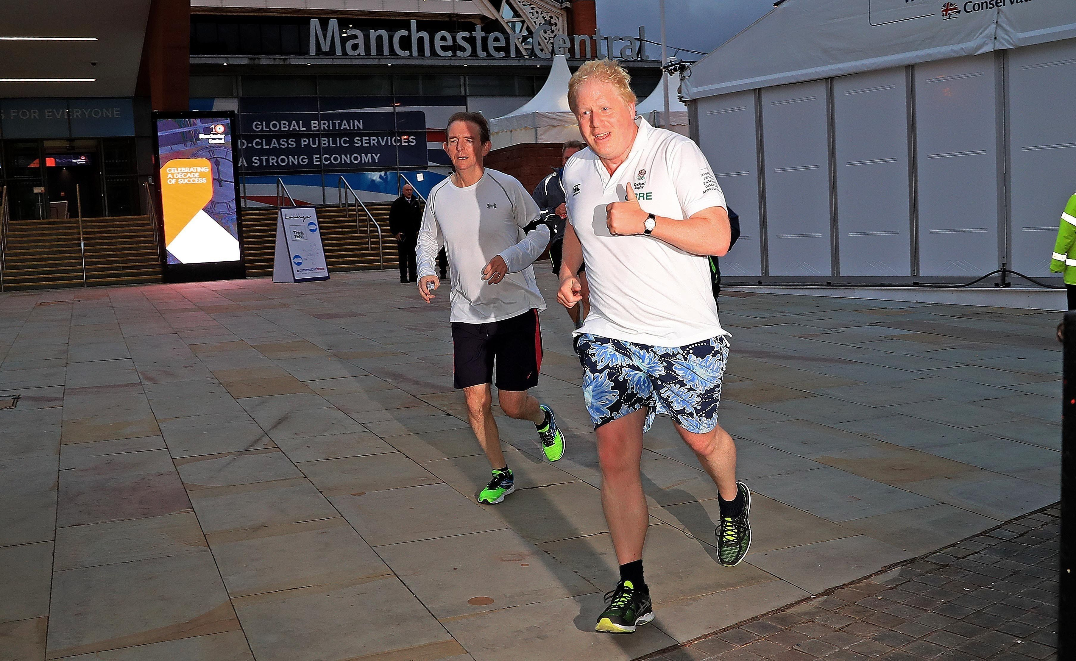 Boris Johnson Snapped On A Morning Jog With The Editor Of The