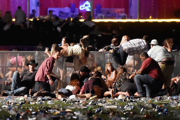 Concertgoers duck for cover as gunman Stephen Paddock opens fire from the 32nd floor of theMandalay...