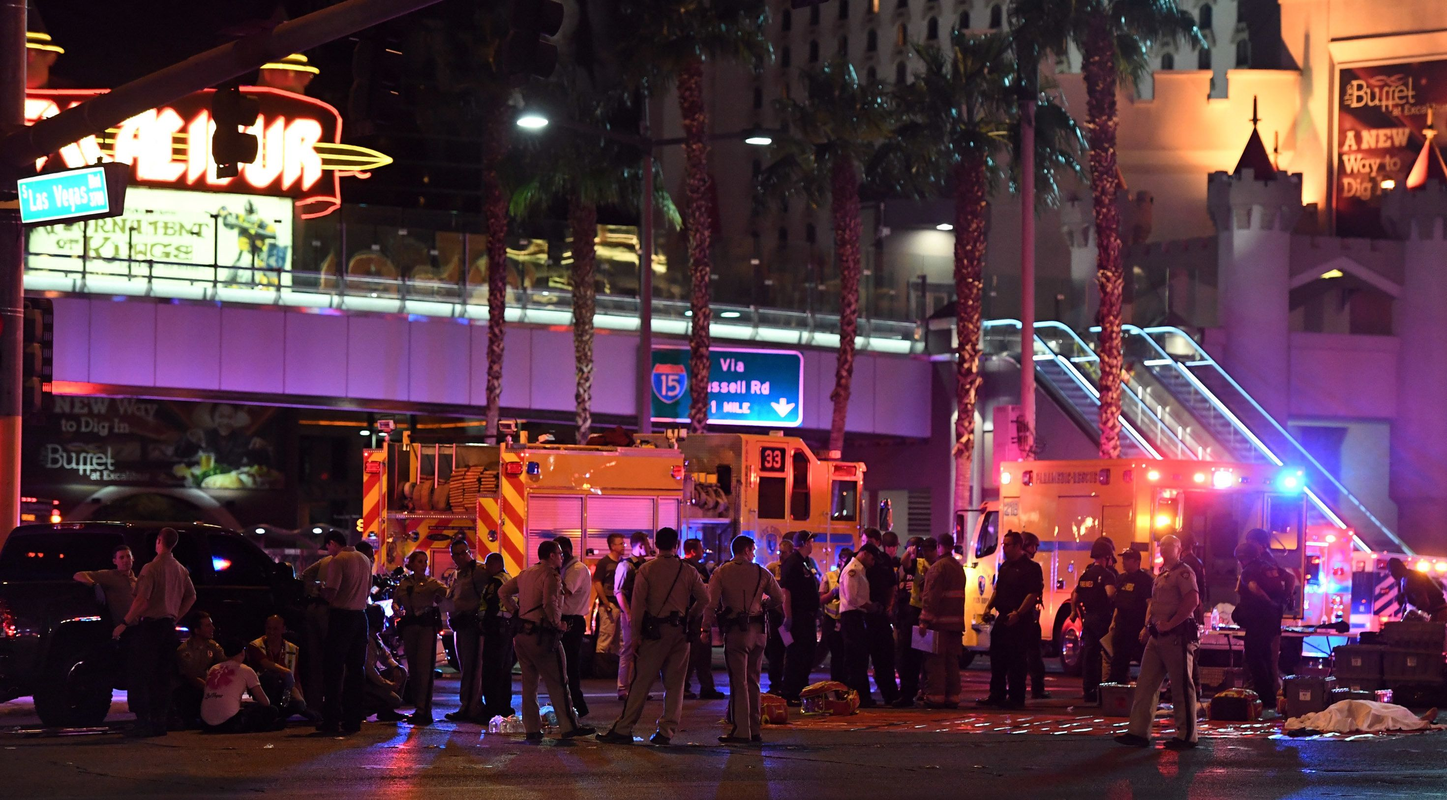 LAS VEGAS, NV - OCTOBER 01:  A body appears to lie under a sheet as police and rescue personnel gather at the intersection of Las Vegas Boulevard and Tropicana Ave on October 1, 2017 in Las Vegas, Nevada. A gunman has opened fire on a music festival in Las Vegas, leaving at least 2 people dead. Police have confirmed that one suspect has been shot. The investigation is ongoing. (Photo by Ethan Miller/Getty Images)