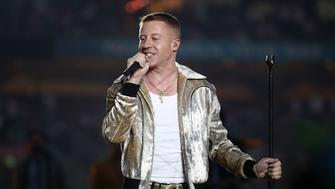 SYDNEY, AUSTRALIA - OCTOBER 01:  Macklemore performs before the 2017 NRL Grand Final match between the Melbourne Storm and the North Queensland Cowboys at ANZ Stadium on October 1, 2017 in Sydney, Australia.  (Photo by Cameron Spencer/Getty Images)