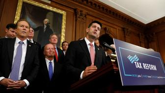 Surrounded by Republicans, Speaker of the House Paul Ryan speaks about the Republican tax plan in the U.S. Capitol in Washington, U.S., September 27, 2017. REUTERS/Kevin Lamarque