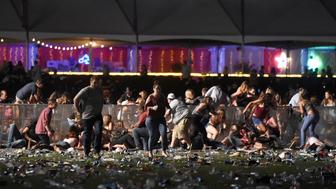 LAS VEGAS, NV - OCTOBER 01  People run from the Route 91 Harvest country music festival after apparent gun fire was heard on October 1, 2017 in Las Vegas, Nevada.  There are reports of an active shooter around the Mandalay Bay Resort and Casino.  (Photo by David Becker/Getty Images)