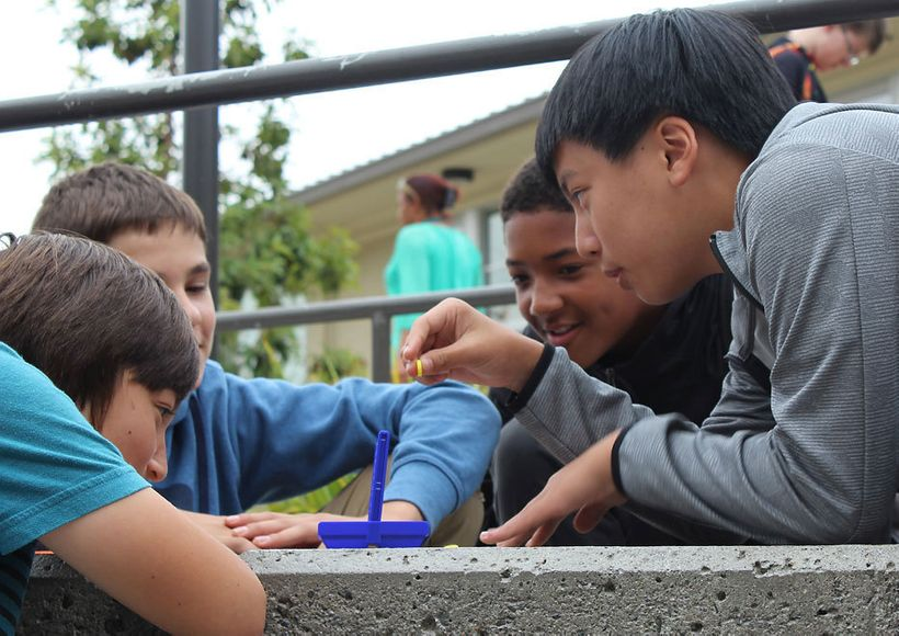 With no cell phones to toy with, middle school students play a game after lunch at Korematsu Middle