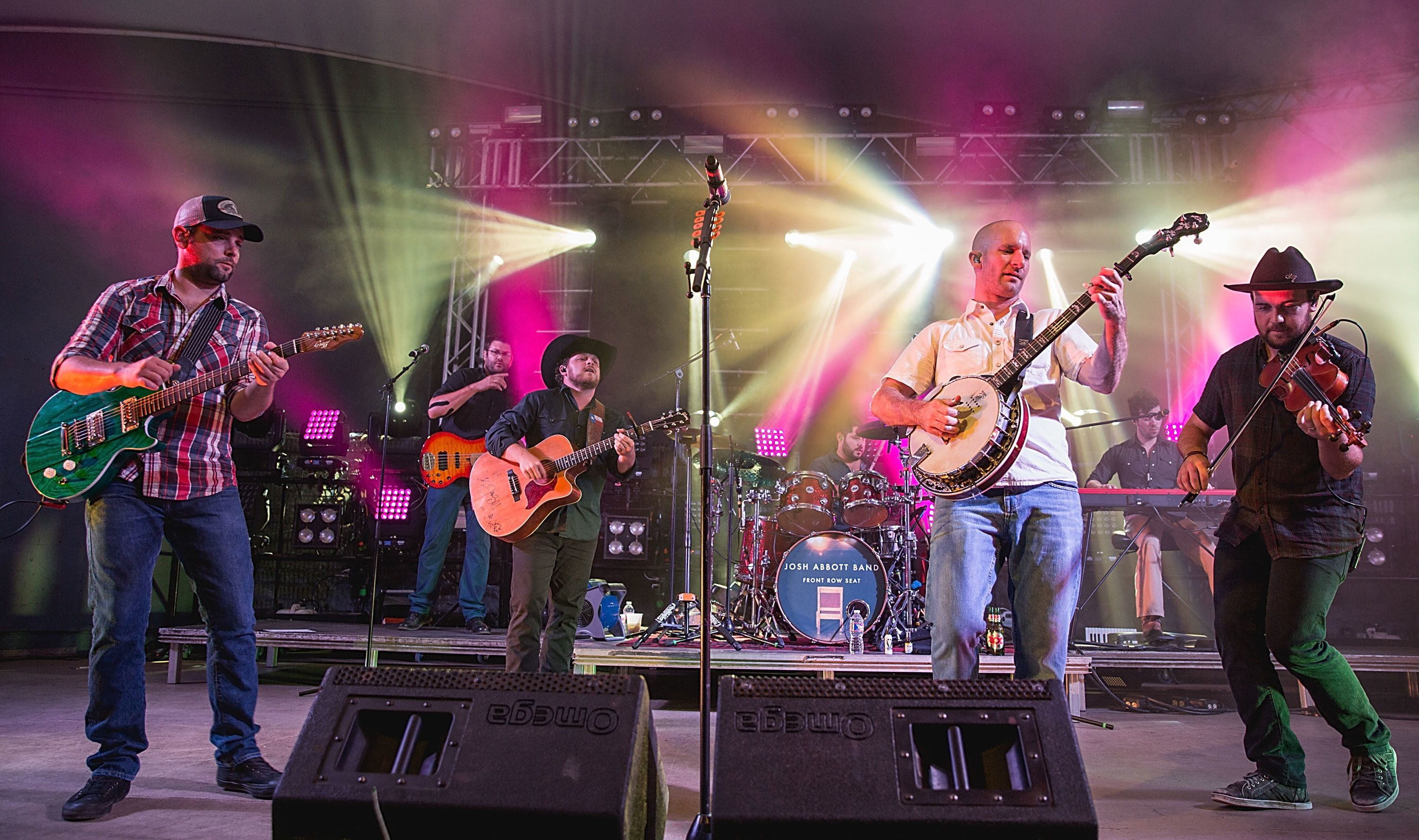 Caleb Keeter, left, performs with the Josh Abbott Band in