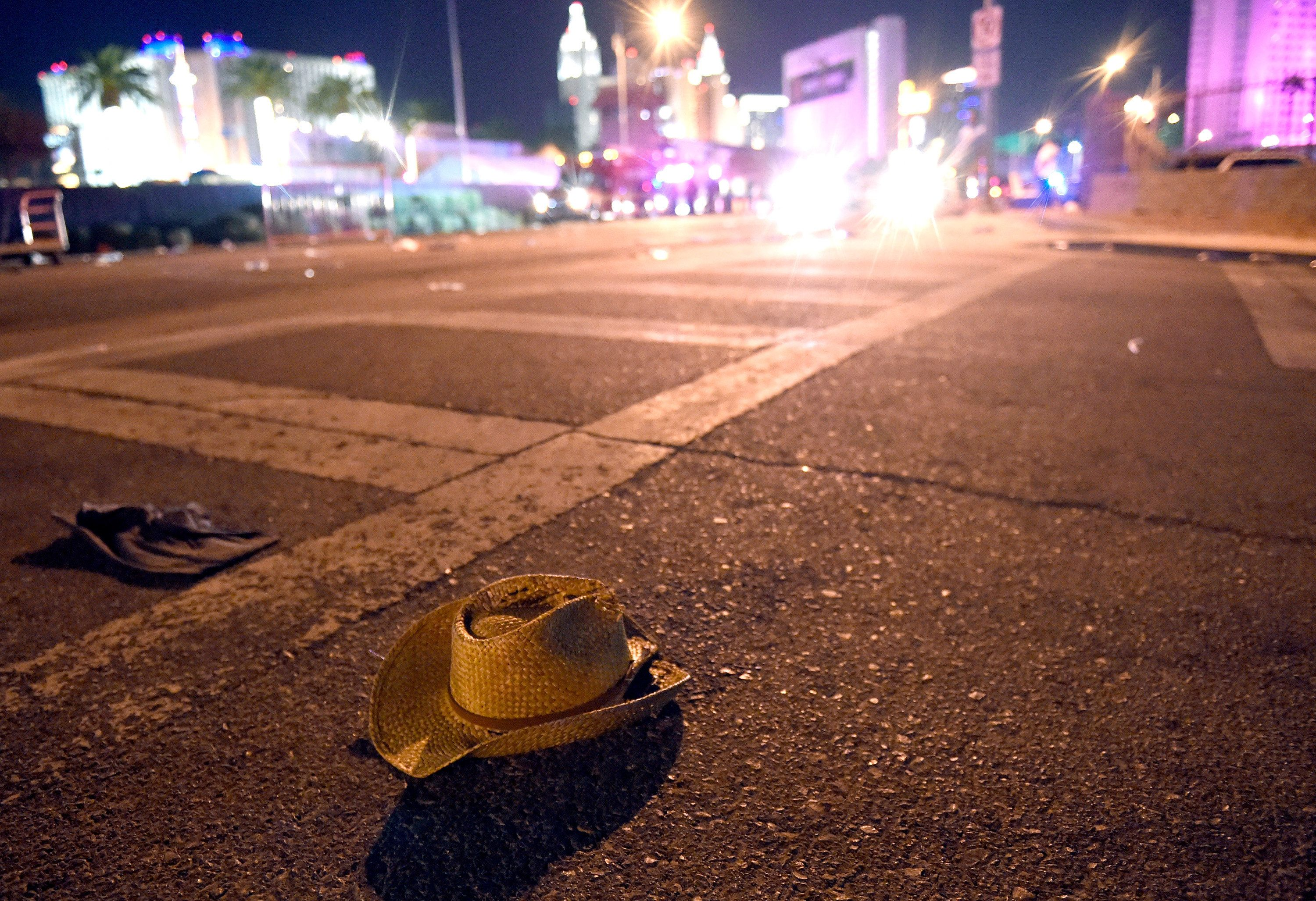 A cowboy hat lays in the street after shots were fired near a country music festival on Sunday in Las Vegas.