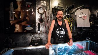 Rod Caldwell co-owner of Spikes Leather Club in Birmingham Alabama stands behind a glass counter