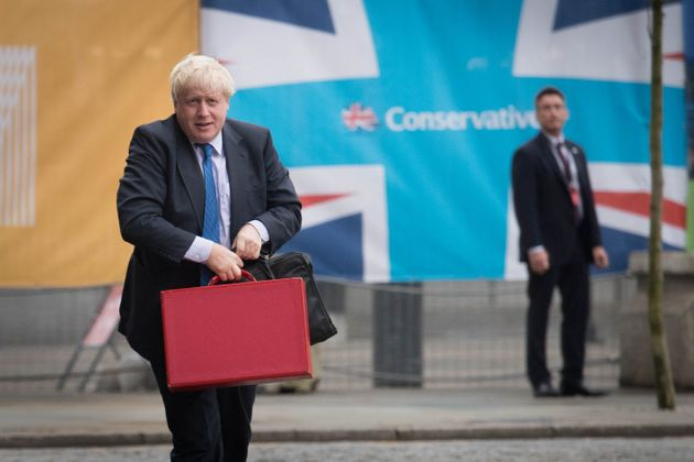 Boris Johnson arrives at the Conservative Party Conference in