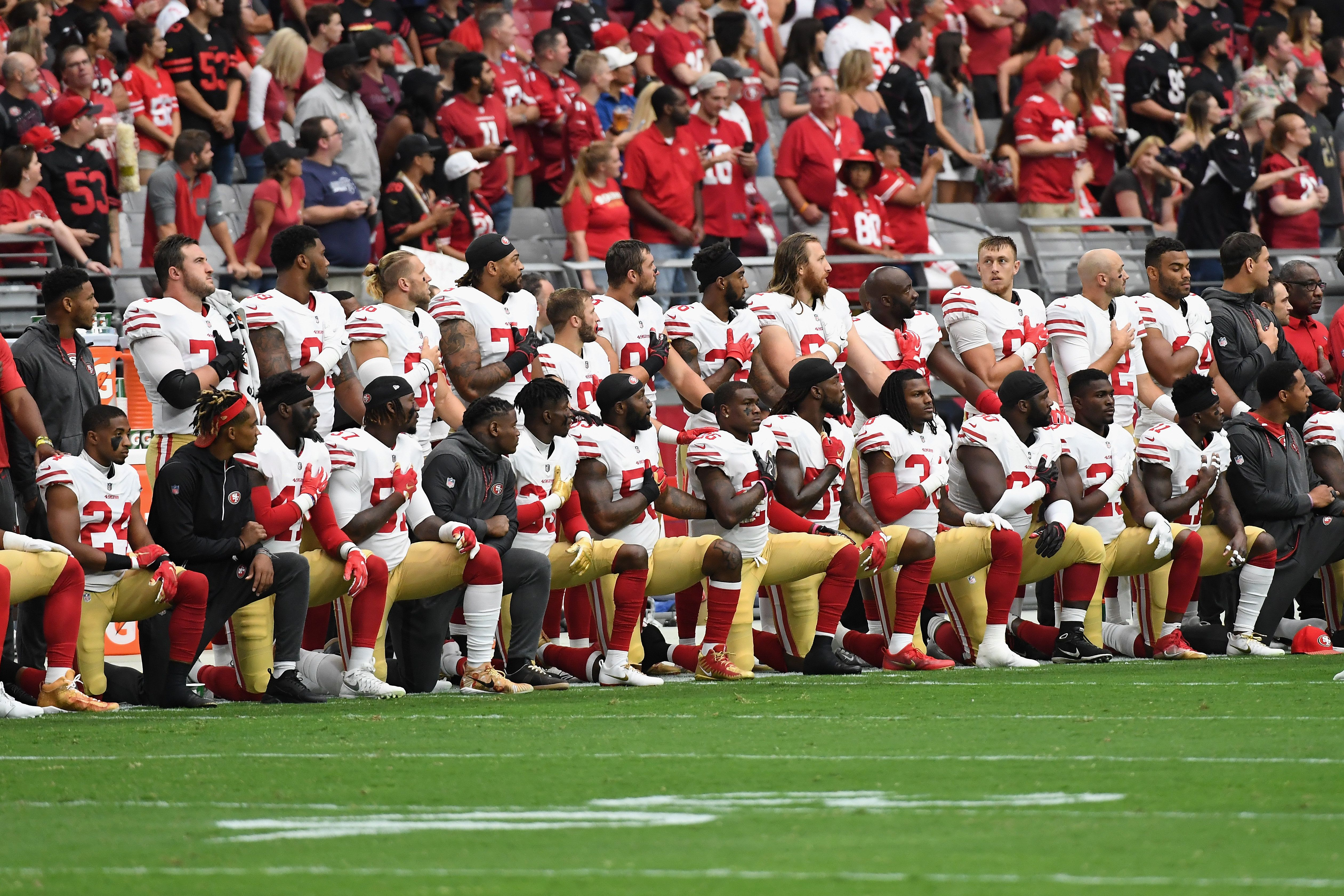 GLENDALE, AZ - OCTOBER 01: Members of the San Francisco 49ers kneel for the National Anthem before the start of the NFL game against the Arizona Cardinals at the University of Phoenix Stadium on October 1, 2017 in Glendale, Arizona.  (Photo by Norm Hall/Getty Images)