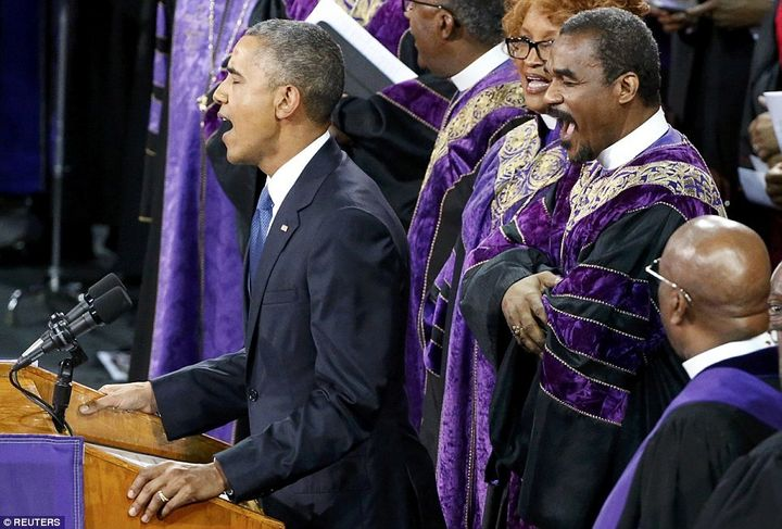 "President Obama, singing ""Amazing Grace,"" at a memorial service in Charleston, South Carolina"