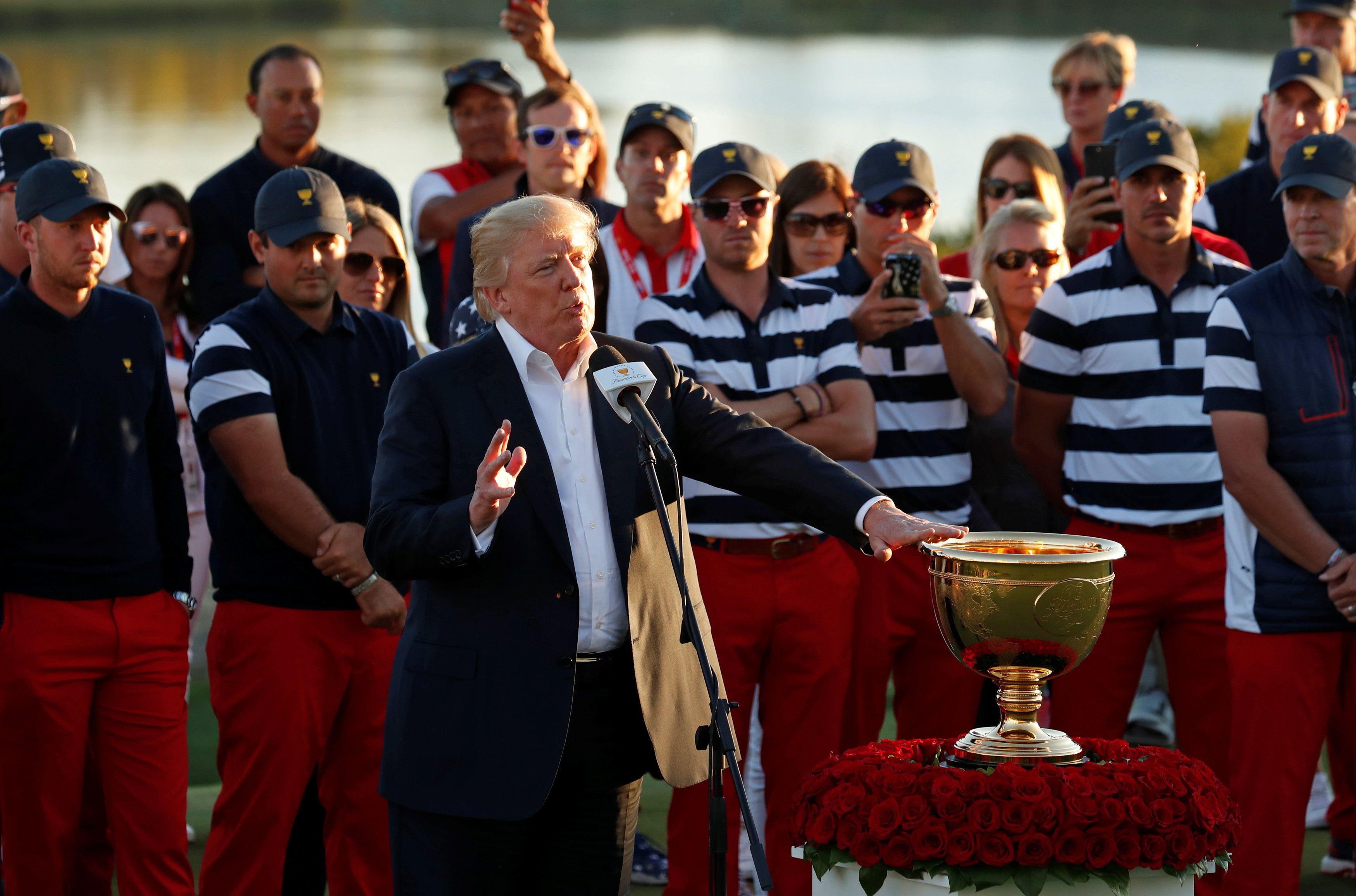 U.S. President Donald Trump speaks before presenting the trophy to the U.S. team captain Steve Stricker at the conclusion of the Presidents Cup golf tournament at Liberty National Golf Club in Jersey City, New Jersey, U.S., October 1, 2017. REUTERS/Kevin Lamarque