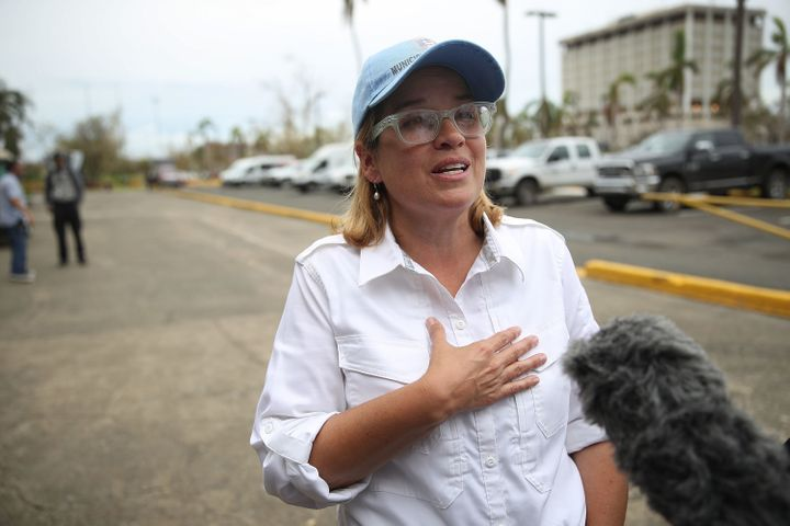 San Juan Mayor Carmen Yulín Cruz speaks to the media as she arrives at the temporary government center at Roberto Clem