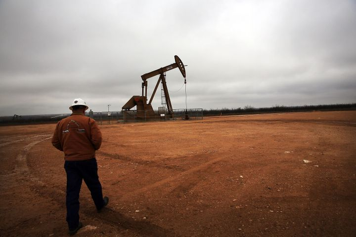 An oil well operates in Texas' Permian Basin.