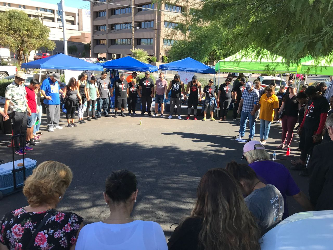 A prayer circle formed outside University Medical Center in Las Vegas on Monday.
