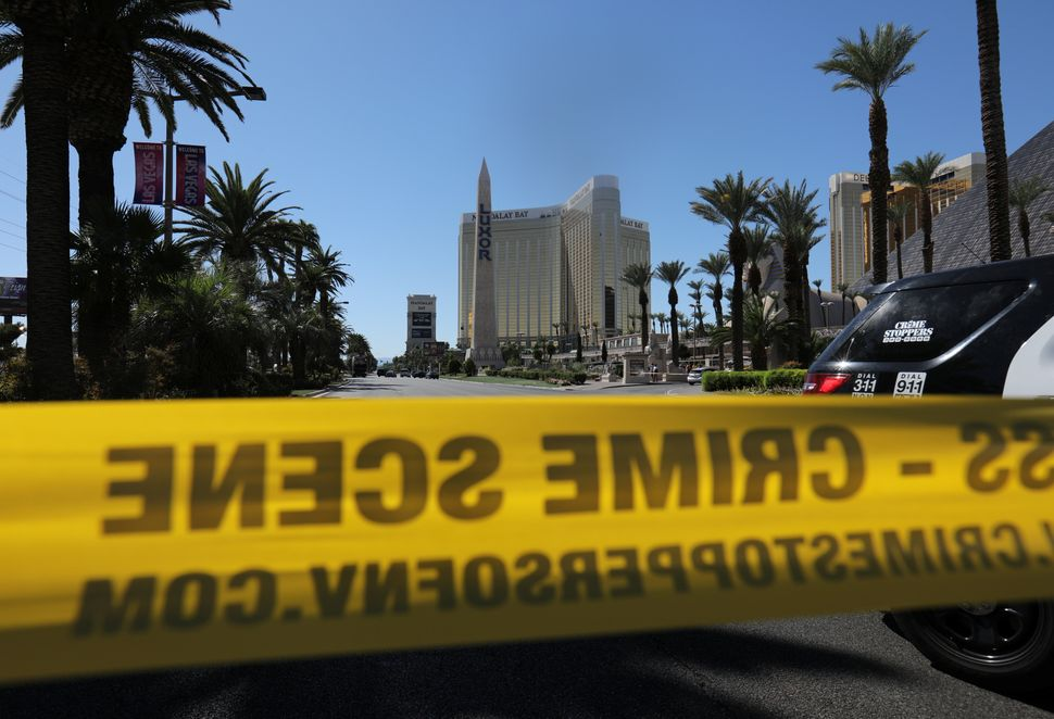 Police crime scene tape marks a perimeter outside the Luxor Las Vegas hotel and the Mandalay Bay Resort and Casino.