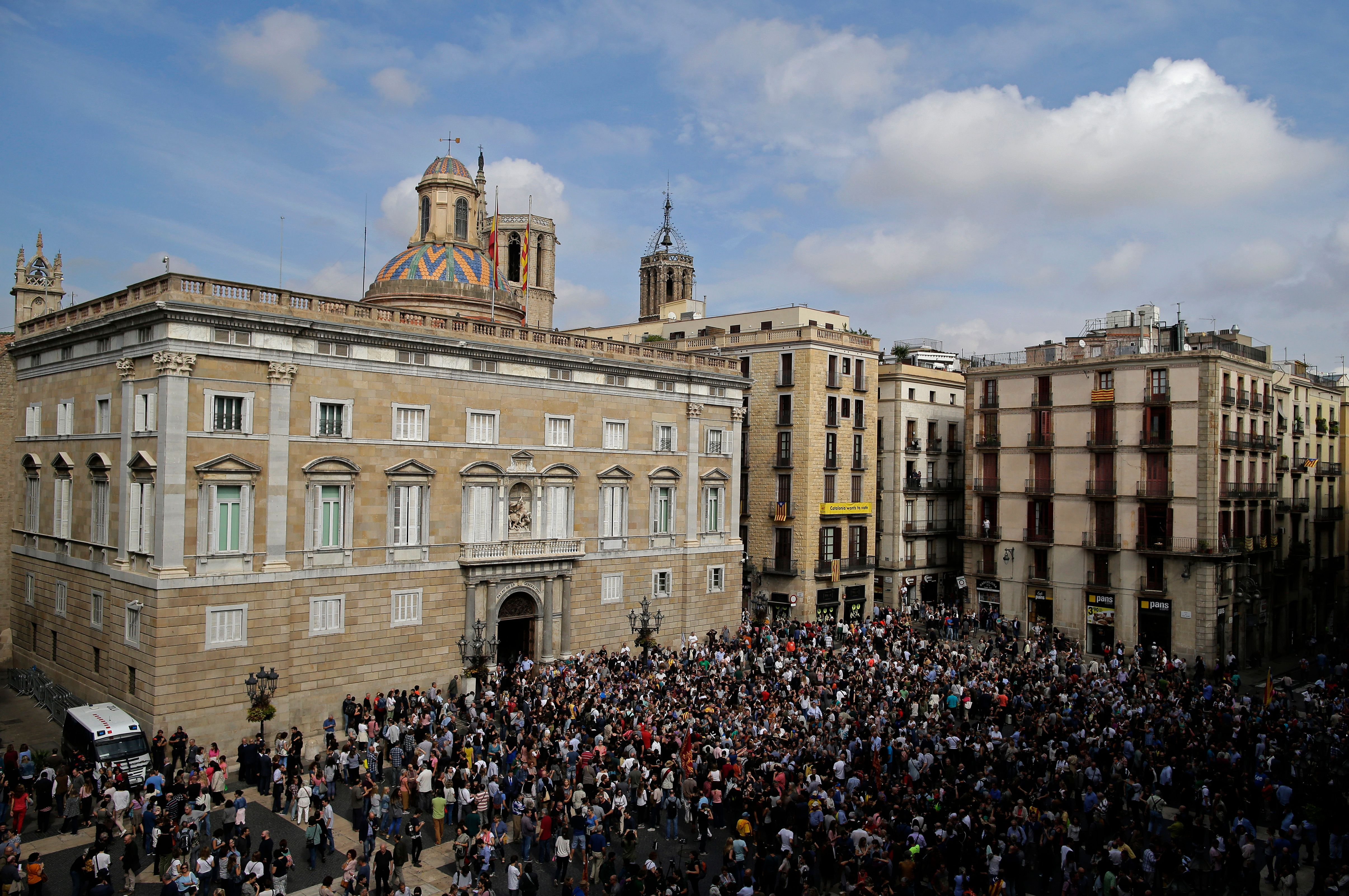 Catalans urged to strike to protest police crackdown on poll