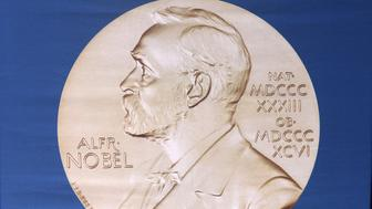 The laureate medal featuring the portrait of Alfred Nobel is seen before a press conference of the Nobel Committee to announce the winner of the 2015 Nobel Medicine Prize on October 5, 2015 at the Karolinska Institutet in Stockholm, Sweden. Swedish inventor and scholar Alfred Nobel, who made a vast fortune from his invention of dynamite in 1866, ordered the creation of the famous Nobel prizes in his will.  AFP PHOTO / JONATHAN NACKSTRAND        (Photo credit should read JONATHAN NACKSTRAND/AFP/Getty Images)