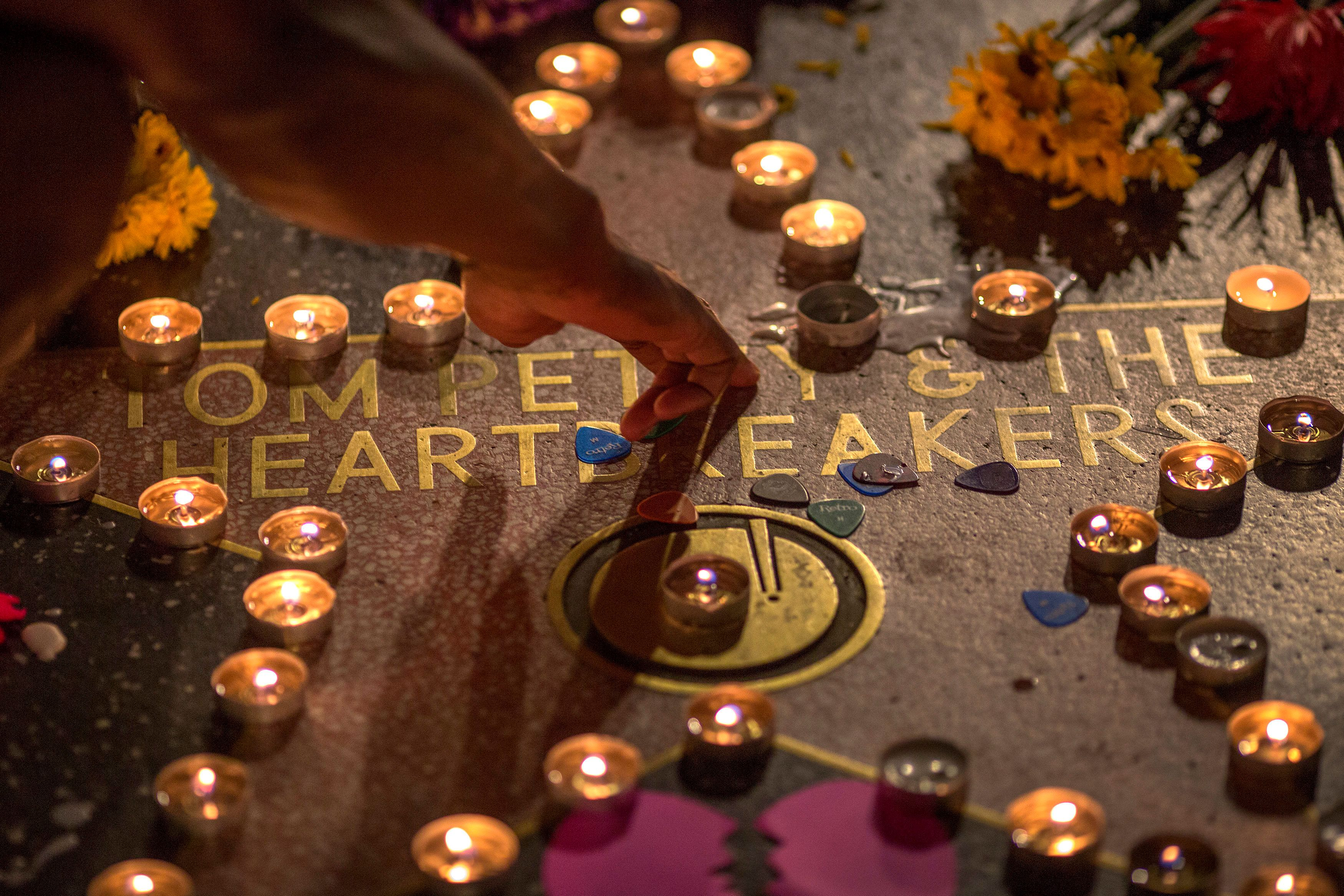 Fans have paid tribute to the music legend, including at his star on the Hollywood Walk of