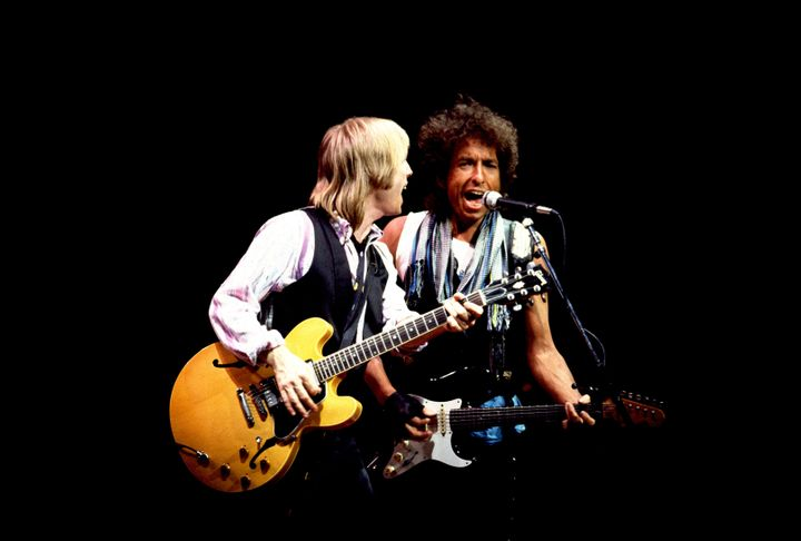Tom Petty (left) and Bob Dylan perform onstage at the Poplar Creek Music Theater in Hoffman Estates, Chicago, Illinois, July