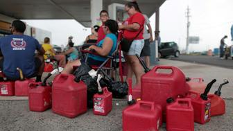 People wait at a gas station to fill up their fuel containers, in the aftermath of Hurricane Maria, in San Juan, Puerto Rico September 27, 2017. Picture taken September 27, 2017. REUTERS/Alvin Baez