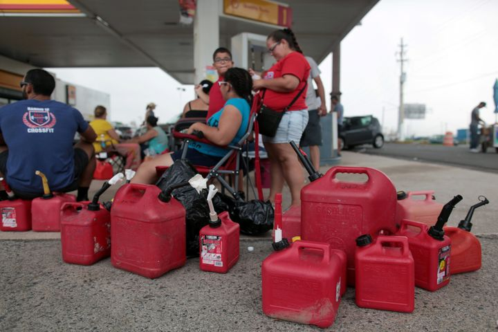 People in San Juan, Puerto Ricowait at a gas station to fill up their fuel containers, in the aftermath of Hurricane Ma